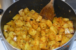 Spices mixed in with potatoes
