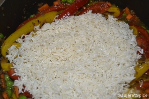 Soaked rice added to vegetables