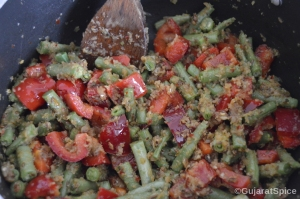 Peppers and green beans mixed with onion mixture