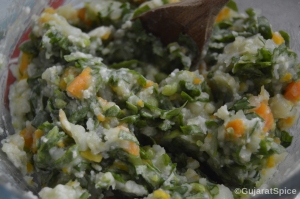 Baby spinach added to mashed vegetable mixture