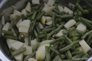 Chopped green beans and diced potatoes