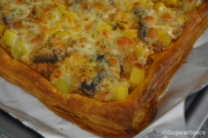 Cooked puff pastry pizza