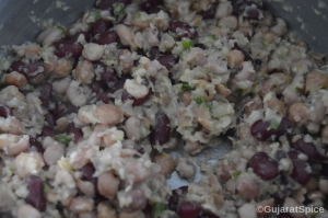 Mixed beans added to onion mixture and combined