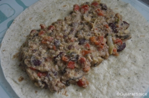 Mexican beans spread on heated wraps