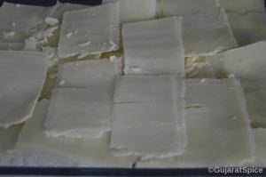 Sliced cheddar layered onto wraps